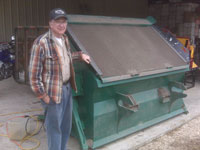 Donald Busby and his new topsoil screener the Green Giant   PVG-12V.